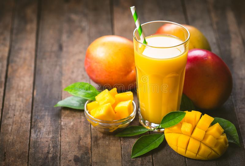 Mango juice in the glass royalty free stock photos