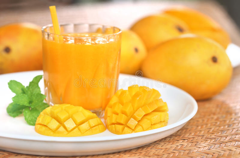 Mango juice with sliced fruit stock photos