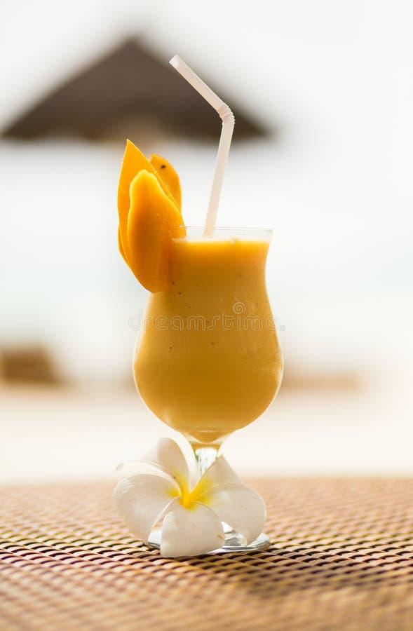 Mango juice on a tropical beach
