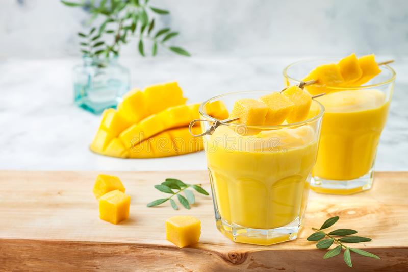 Mango Lassi, yogurt or smoothie with turmeric. Healthy probiotic Indian cold summer drink. stock photography