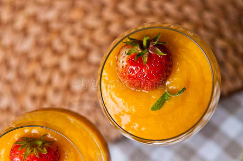 Mango mousse with chia seeds and coconut milk. An elegant table setting with homemade mango mousse with chia seeds, coconut milk, natural yoghurt, maple syrup stock images