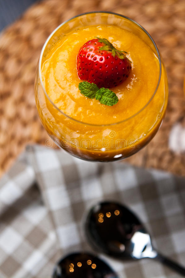 Mango mousse with chia seeds and coconut milk. An elegant table setting with homemade mango mousse with chia seeds, coconut milk, natural yoghurt, maple syrup royalty free stock photos