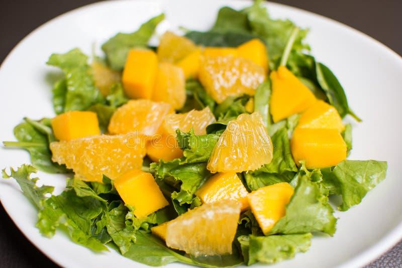 Mango and orange salad royalty free stock image