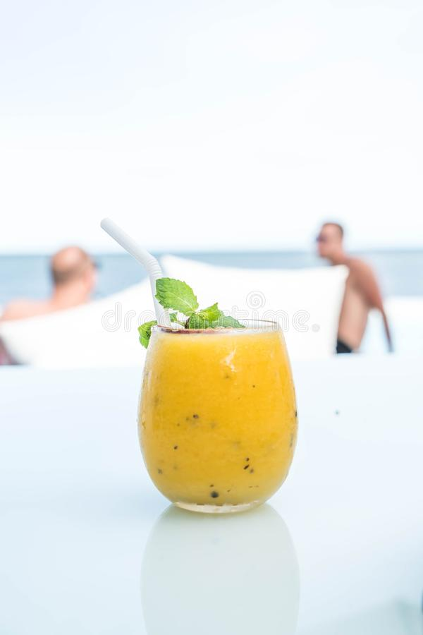 Mango and passion fruit smoothies. With sea background stock image