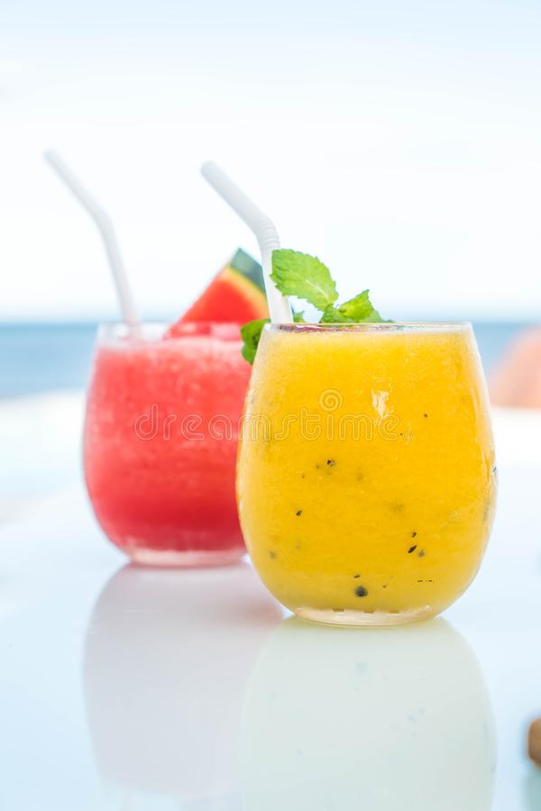 Mango and passion fruit smoothies. With sea background royalty free stock image