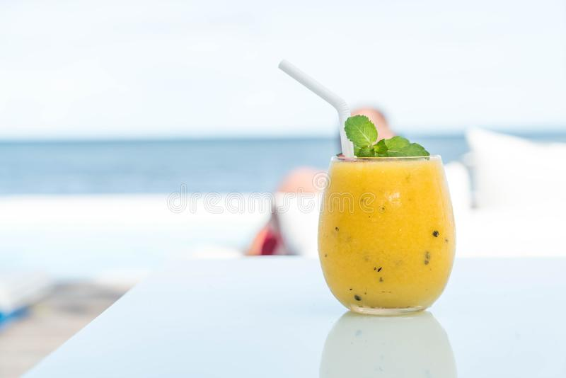 Mango and passion fruit smoothies. With sea background stock photos