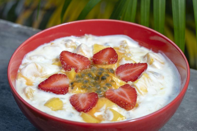 Mango, passion fruit, strawberry and yogurt brulee. Fruit dessert on breakfast with wedges of perfectly ripe in season mangoes and. Mango, passion fruit, red stock photography