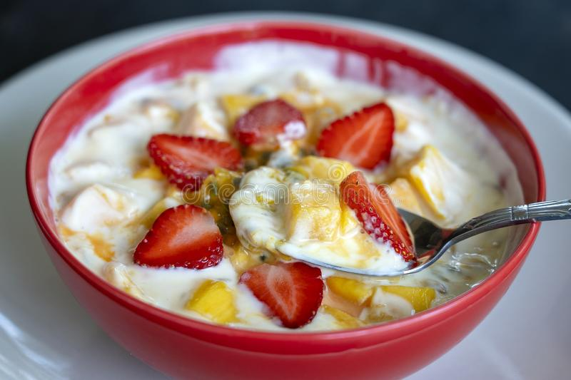 Mango, passion fruit, strawberry and yogurt brulee. Fruit dessert on breakfast with wedges of perfectly ripe in season mangoes and. Mango, passion fruit, red royalty free stock images