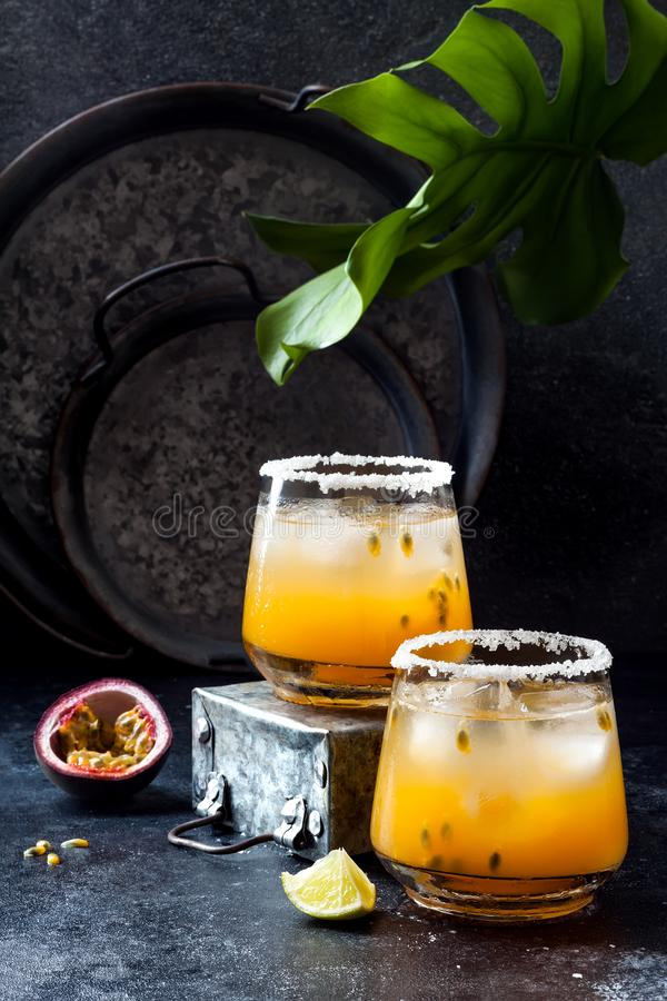 Mango passionfruit margarita cocktail with lime. Tropical alcoholic drink for summer stock photography