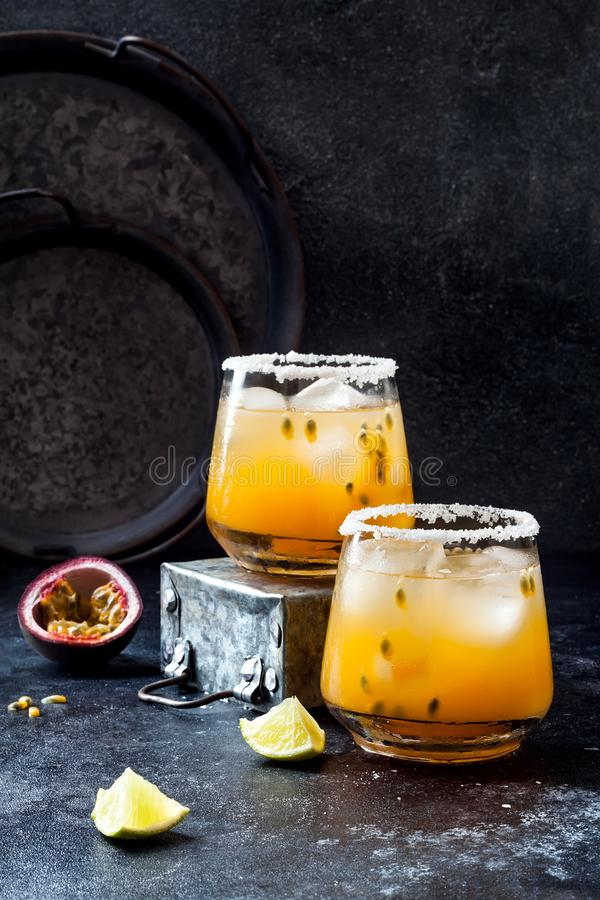 Mango passionfruit margarita cocktail with lime. Tropical alcoholic drink for summer stock image