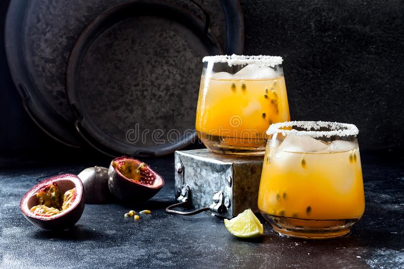 Mango passionfruit margarita cocktail with lime. Tropical alcoholic drink for summer stock photos