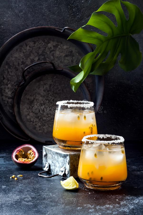 Mango passionfruit margarita cocktail with lime. Tropical alcoholic drink for summer royalty free stock photos
