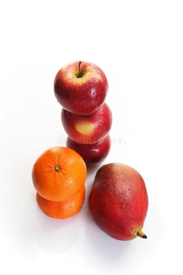 Mango, pomarańcze i jabłka, fotografia royalty free