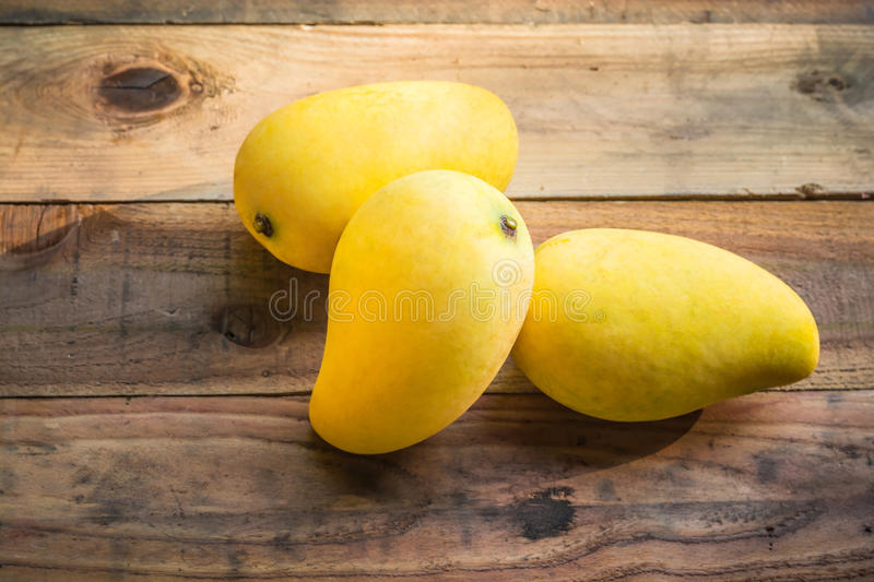 Mango is ripe. On old wooden table royalty free stock photography