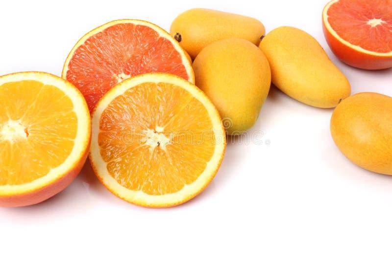Mango's en sinaasappelen royalty-vrije stock foto's