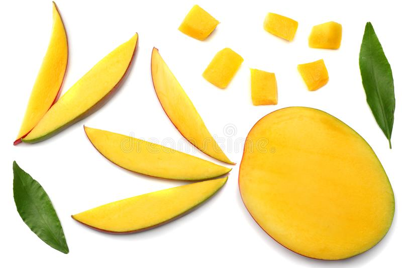 mango slice with green leaves isolated on white background. top view stock photo
