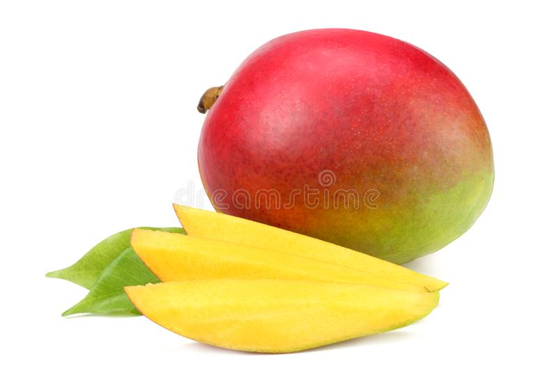 mango with slices and green leaves isolated on white background. healthy food. stock photos