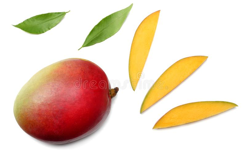 mango with slices and green leaves isolated on white background. healthy food. top view stock photo