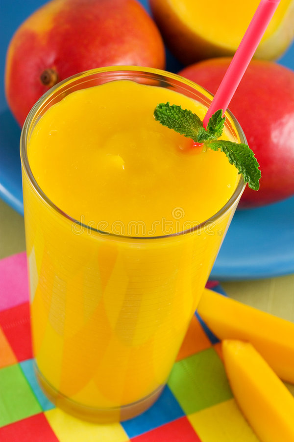 Mango smoothie. With mint royalty free stock images