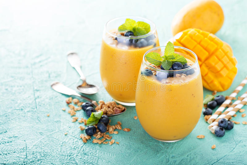 Mango smoothie in glasses royalty free stock photography