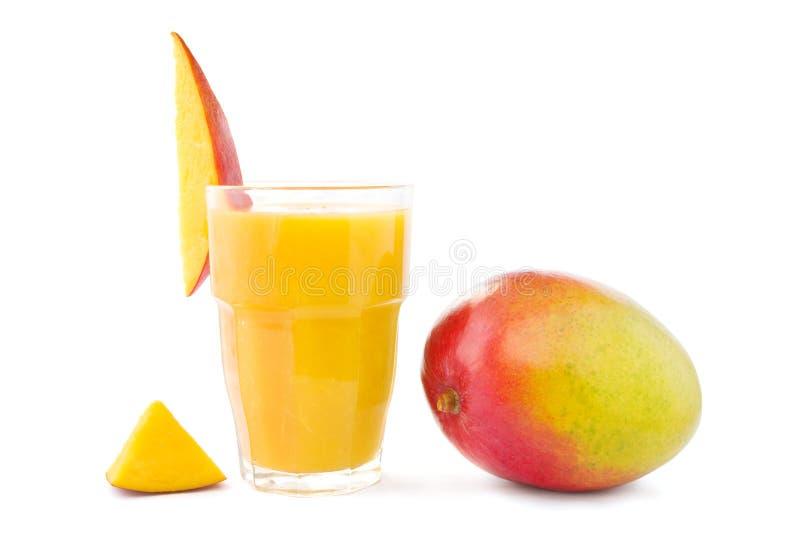 Mango smoothie with mango. Big glass of mango smoothie with a mango stock photos