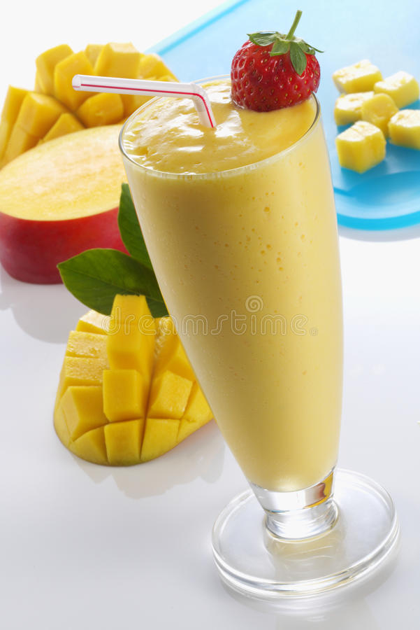 Mango Smoothie. Topped with a strawberry stock photography