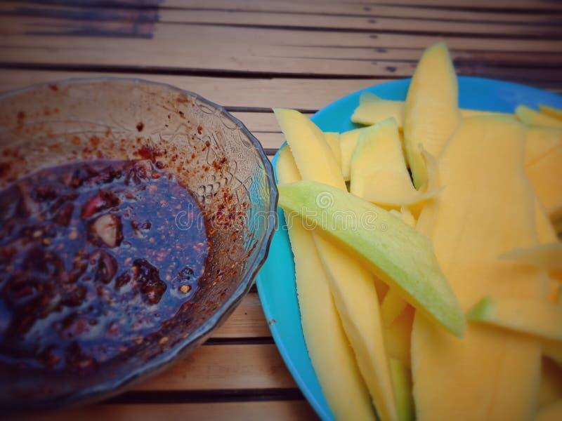 Mango and spicy fish sauce stock photos