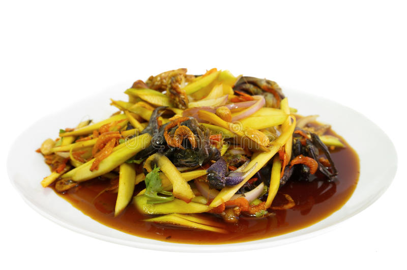 Mango spicy salad with black crab stock photography