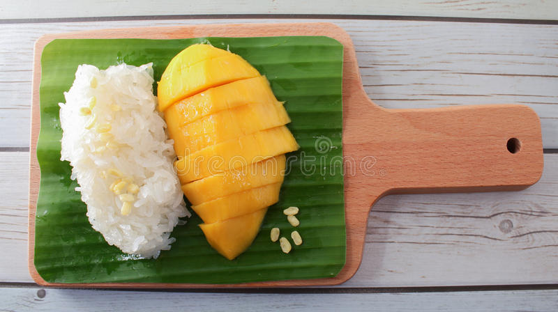 Mango Sticky Rice with Wood Tray, Thai dessert stock photo