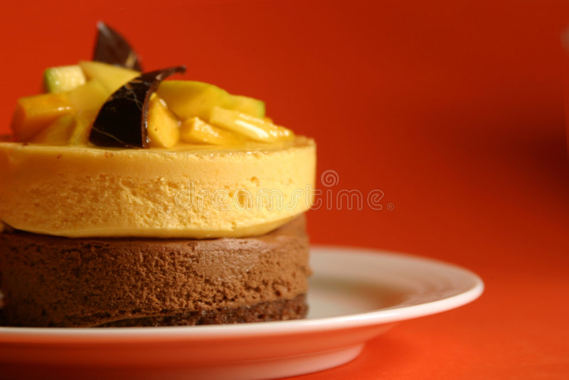 Mangofrucht und Schokoladencreme stockbild