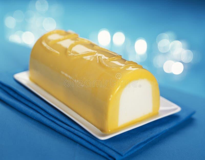 Mangofrucht-Zitrone Eiscreme-Protokollkuchen stockfotografie