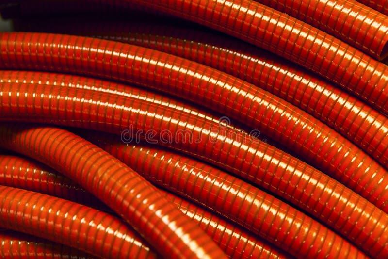 Mangueras plásticas rojas foto de archivo
