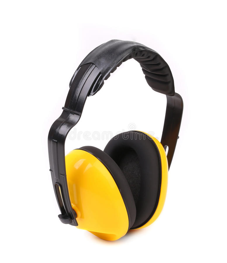 Manguitos protectores amarillos del oído. imagenes de archivo