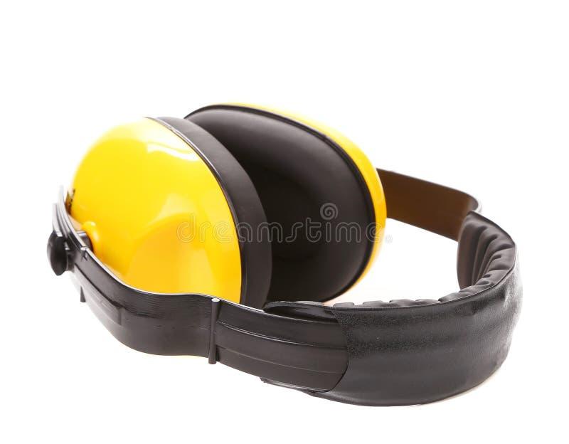 Manguitos protectores amarillos del oído. imagen de archivo