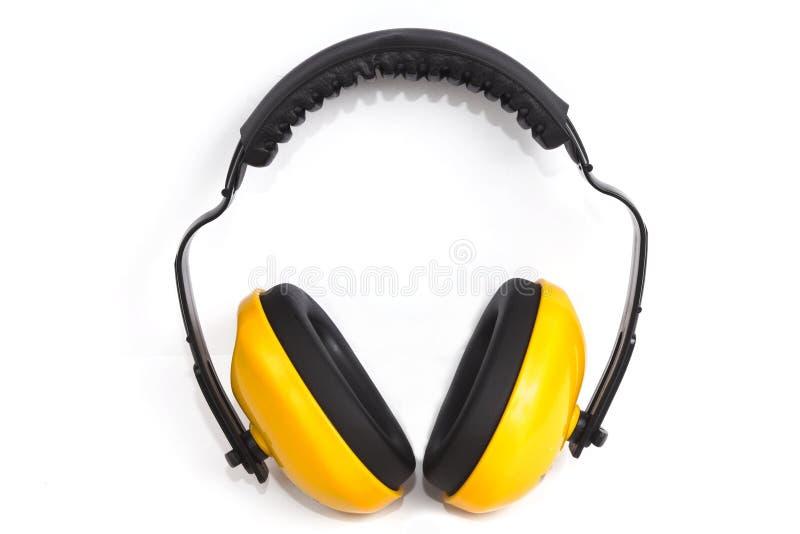 Manguitos protectores amarillos del oído fotos de archivo libres de regalías