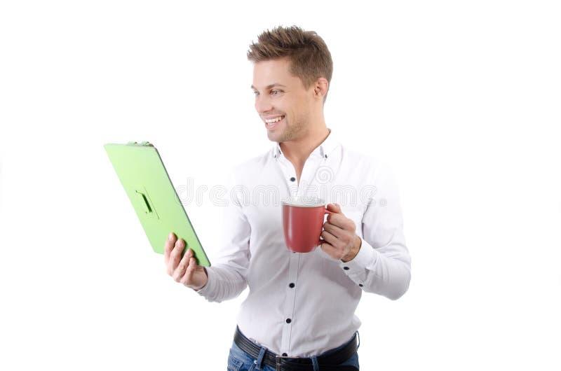 Manhã Homem de negócios feliz novo que guarda uma tabuleta foto de stock royalty free