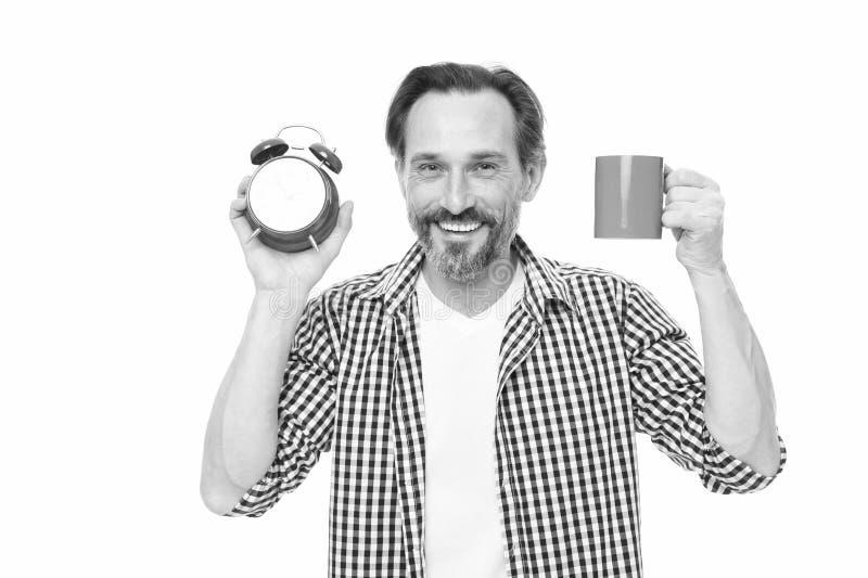 Manh?llringklocka och att r?na kaffe Morgonvanor Ta kontroll over tid Kontrollera tid Spetsar f?r sparande tid sj?lv fotografering för bildbyråer