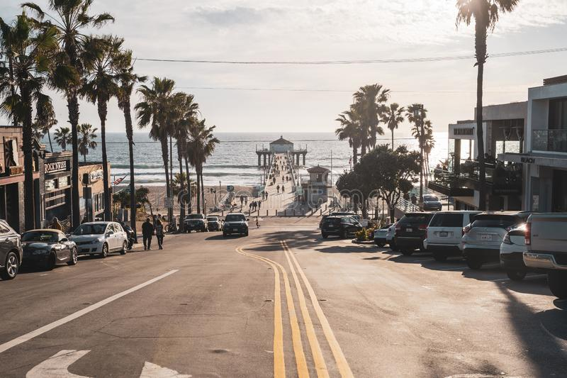 Manhattan Beach, California: View of the Manhattan Beach Pier as seen from downtown, in the late afternoon royalty free stock photography
