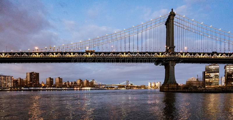 Manhattan Bridge, as seen from Dumbo Park during twilight. BROOKLYN, NEW YORK, MAR 27, 2018: Manhattan Bridge, as seen from Dumbo Park during twilight royalty free stock image