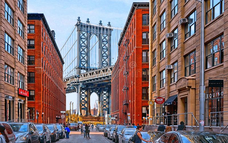 Manhattan Bridge and brick wall old buildings and architectures with people on the street in Brooklyn in DUMBO district, Manhatta stock image