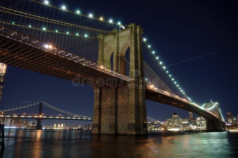 Manhattan Bridge and Brooklyn Skyline at night stock photography