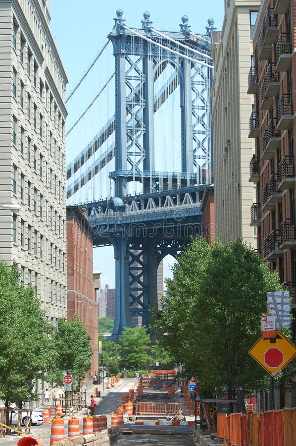 Manhattan Bridge, New York City. The Manhattan Bridge rises above the streets of DUMBO (Down Under the Manhattan Bridge) a trendy Brooklyn neighborhood of royalty free stock photography