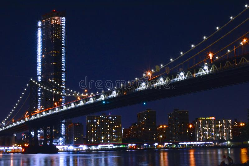 Manhattan Bridge Night Time. This is a night time shot of the Manhattan Bridge in New York City. This shot was taken from Brooklyn Bridge Park in Brooklyn, NY royalty free stock photography