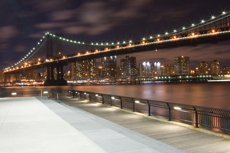 Manhattan Bridge with NYC Skyline. Taken from the Brooklyn Bridge Park royalty free stock image