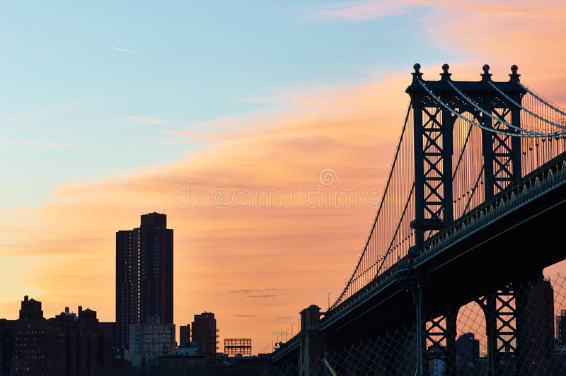Manhattan Bridge and skyline silhouette view from Brooklyn at sunset royalty free stock photos