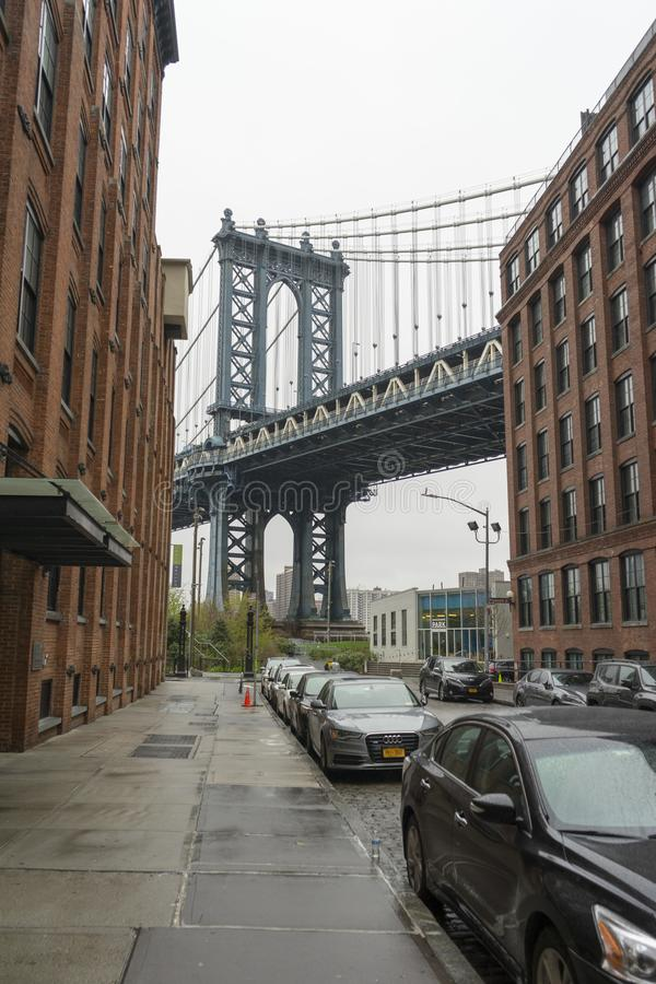 Manhattan bridge view from Brooklyn Dumbo neighbourhood. NEW YORK CITY,NY - APRIL 25,2018 : Manhattan bridge view from Brooklyn Dumbo neighbourhood. Manhattan royalty free stock image