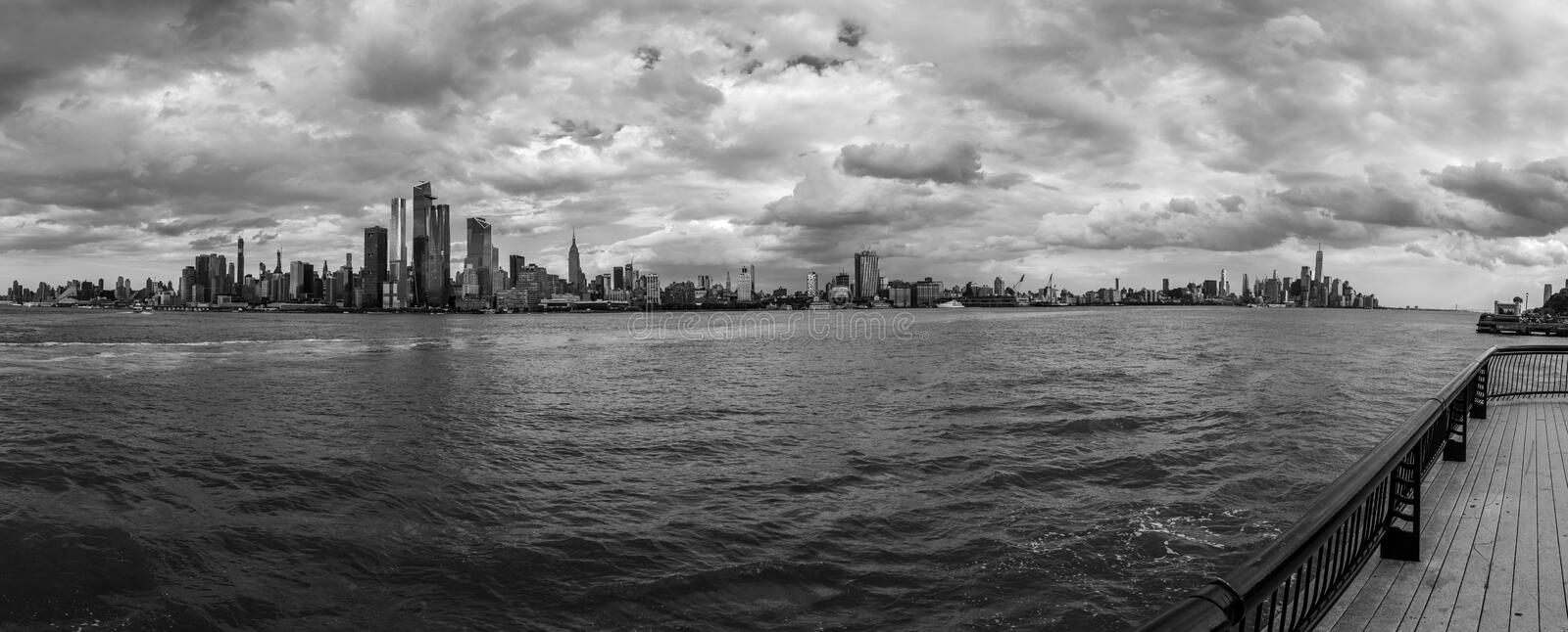 Panorama of Manhattan from New Jersey. Manhattan on a cloudy afternoon as seen from Hoboken royalty free stock photo