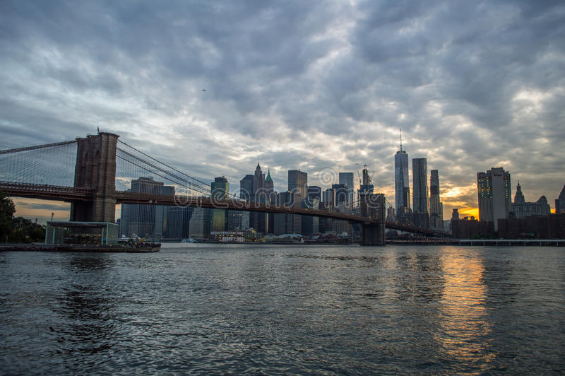 Manhattan Downtown Financial District Skyline and Brooklyn Bridge as Seen from Mainstreet Park in Brooklyn at Sunset stock photos