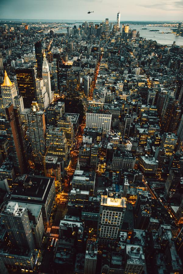 Manhattan New York City buildings lights aerial top view at the night time royalty free stock photography