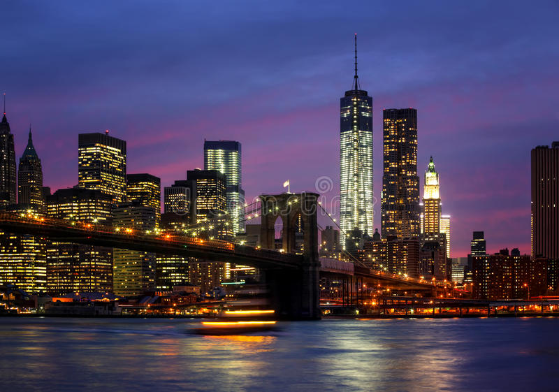 Manhattan at night with lights and reflections royalty free stock photography